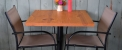 table-with-two-empty-chairs